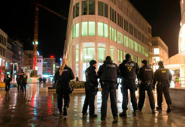Heavy armed police patrol downtown Hanover after the match was called off by police due to a security threat