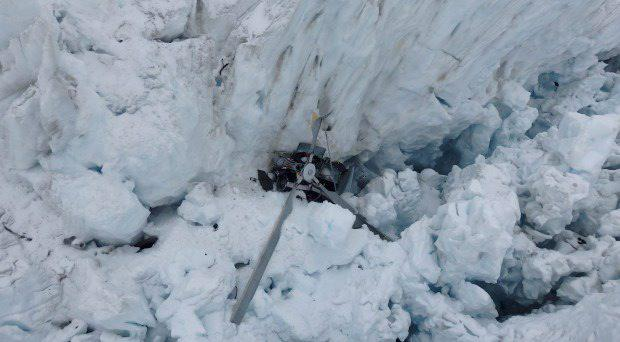 The wreckage of the helicopter, which crashed, killing all seven people on board, is seen in a crevasse on Fox Glacier