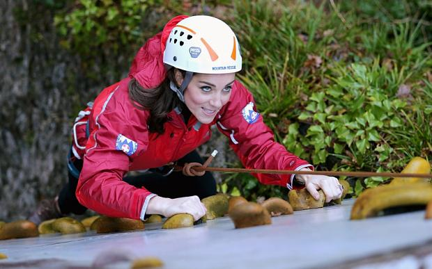 Catherine, Duchess of Cambridge ascends a climbing wall as she visits the Towers Residential Outdoor Education Centre on November 20, 2015 in Capel Curig, United Kingdom