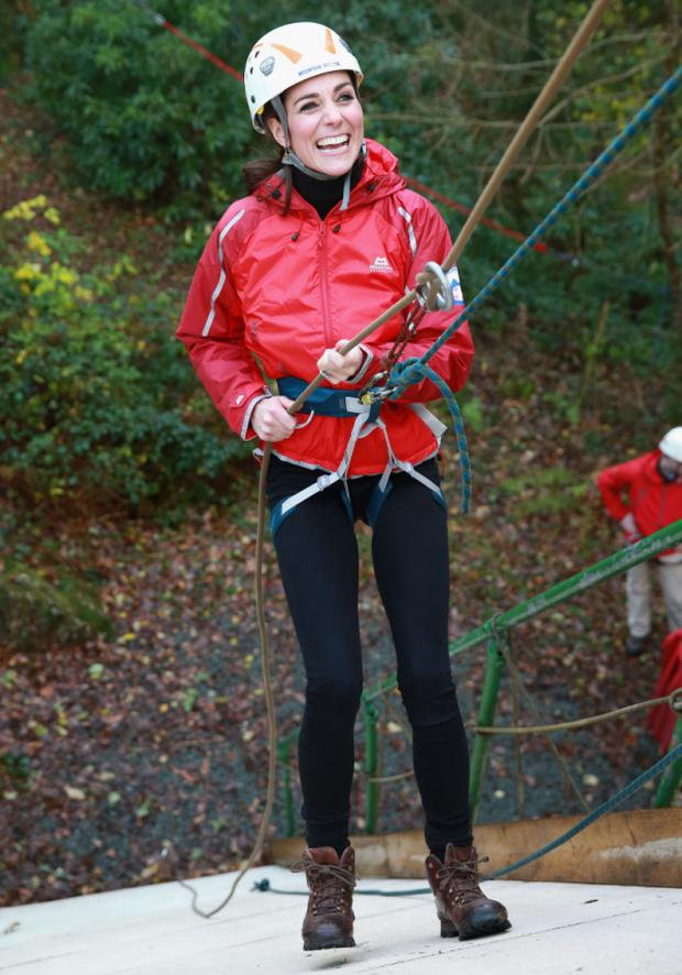 Catherine, Duchess of Cambridge abseils as she visits the Towers Residential Outdoor Education Centre on November 20, 2015 in Capel Curig, United Kingdom