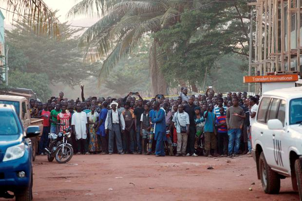 People stand near the Radisson hotel in Bamako, Mali, November 20, 2015. REUTERS/Joe Penney