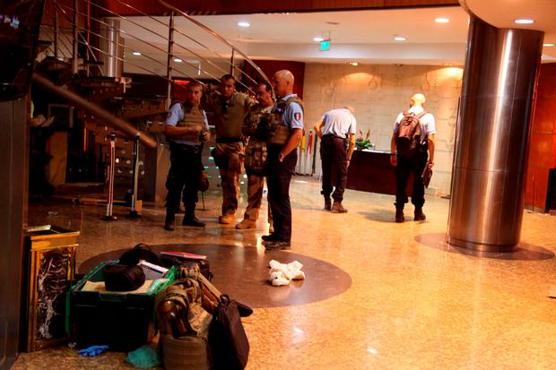 French troops, rear, inside the Radisson Blu hotel after an attack by gunmen on the hotel in Bamako, Mali, Friday, Nov. 20, 2015