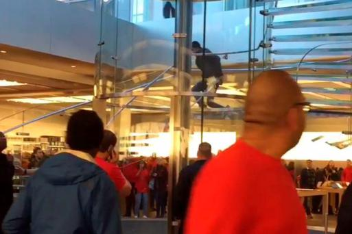 Mr Chien can be used holding the large blade as he walks down the glass stairs Credit: Jimmy Chen\Banjo
