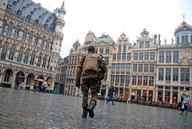 A Belgian soldier patrols on Brussels Grand Place in central Brussels, November 21, 2015, after security was tightened in Belgium following the fatal attacks in Paris. Belgium raised the alert status for its capital Brussels to the highest level on Saturday, shutting the metro and warning the public to avoid crowds because of a