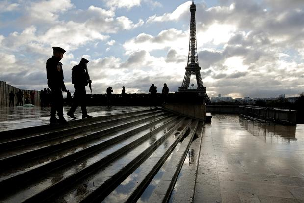 French soldiers patrol the Trocadero place near the Eiffel Tower, in Paris. (AP Photo/Laurent Cipriani)