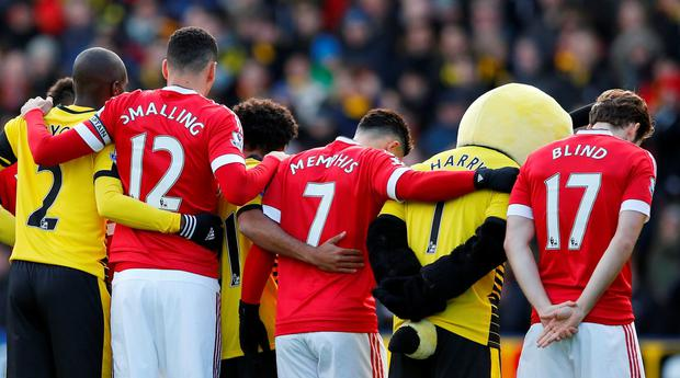 Football - Watford v Manchester United - Barclays Premier League - Vicarage Road - 21/11/15 Players during a minutes silence for the Paris attacks before the match Action Images via Reuters / John Sibley Livepic EDITORIAL USE ONLY. No use with unauthorized audio, video, data, fixture lists, club/league logos or