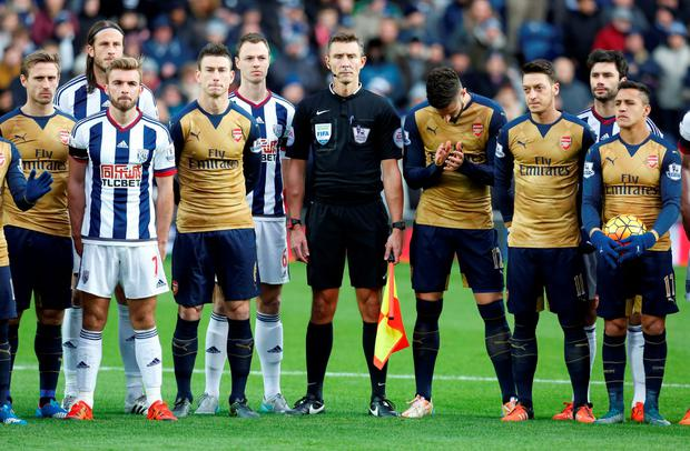 Football - West Bromwich Albion v Arsenal - Barclays Premier League - The Hawthorns - 21/11/15 Players line up in memory of the Paris attacks before the match Action Images via Reuters / Ed Sykes Livepic EDITORIAL USE ONLY. No use with unauthorized audio, video, data, fixture lists, club/league logos or