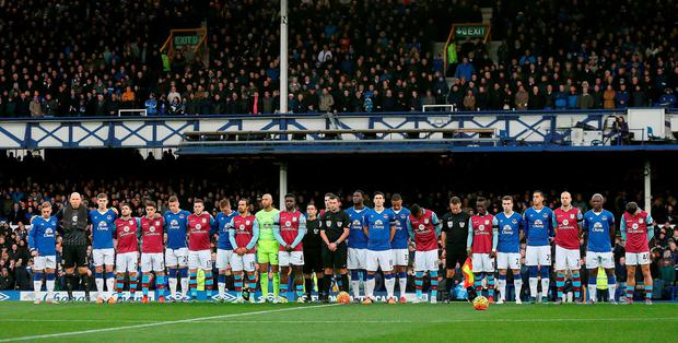 Everton and Aston Villa players stand together for a minutes silence before the Barclays Premier League match at Goodison Park, Liverpool. PRESS ASSOCIATION Photo. Picture date: Saturday November 21, 2015. See PA story SOCCER Everton. Photo credit should read: Barrington Coombs/PA Wire. RESTRICTIONS: EDITORIAL USE ONLY No use with unauthorised audio, video, data, fixture lists, club/league logos or
