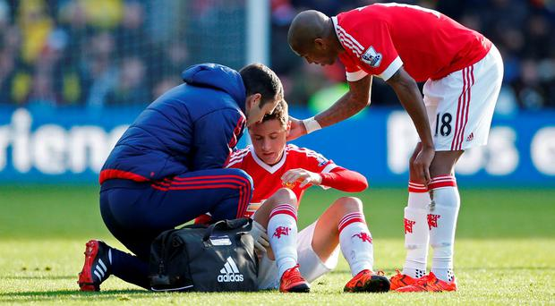 Manchester United's Ander Herrera receives treatment before going off injured
