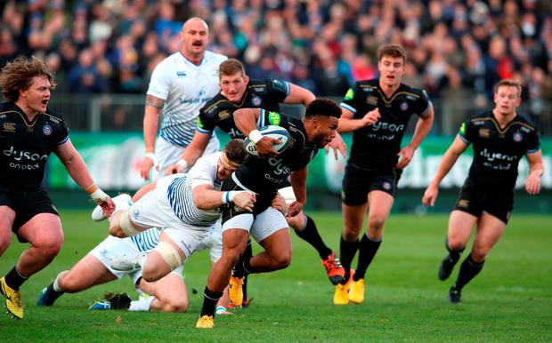 BATH, ENGLAND - NOVEMBER 21: Kyle Eastmond of Bath is tackled by Jamie Heaslip during the European Rugby Champions Cup match between Bath and Leinster at the Recreation Ground on November 21, 2015 in Bath, England. (Photo by David Rogers/Getty Images)