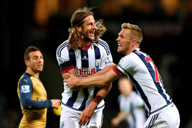 West Brom's Jonas Olsson celebrates before realising that his header did not cross the line