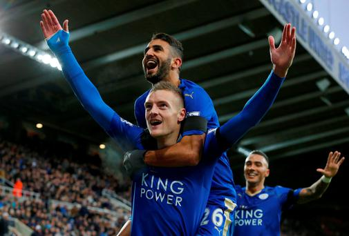 Leicester City's English striker Jamie Vardy (Below L) celebrates