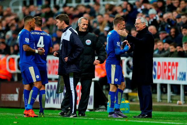 Claudio Ranieri (R) Manager of Leicester City congratulates Jamie Vardy (L)