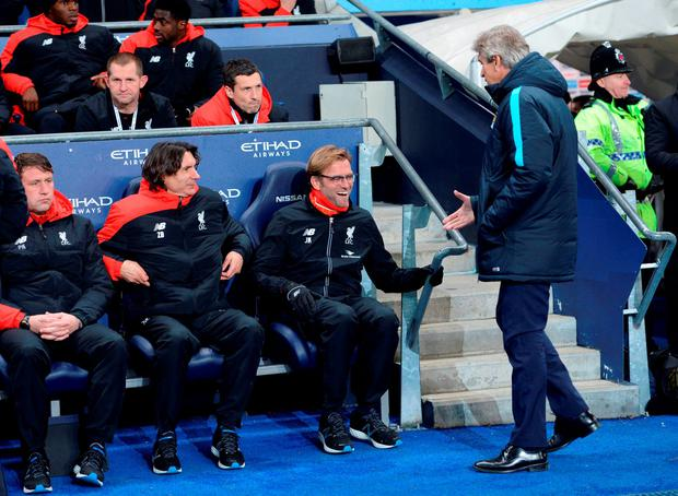 Liverpool's German manager Jurgen Klopp shakes hands with Manchester City's Chilean manager Manuel Pellegrini