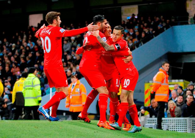Liverpool celebrate after Manchester City's Eliaquim Mangala scored an own