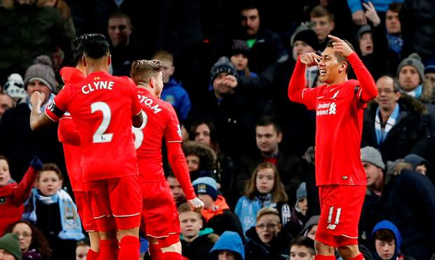 Roberto Firmino celebrates scoring the third goal for Liverpool