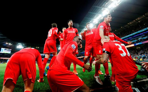 Martin Skrtel (R) celebrates with team mates after scoring the fourth goal for Liverpool
