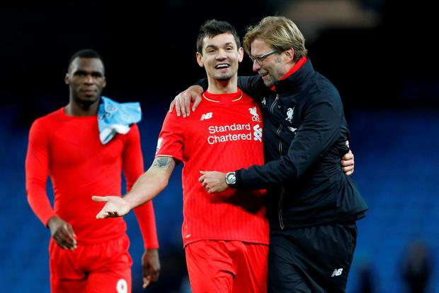 Football - Manchester City v Liverpool - Barclays Premier League - Etihad Stadium - 21/11/15 Liverpool manager Juergen Klopp celebrates with Dejan Lovren after the game Action Images via Reuters / Carl Recine Livepic EDITORIAL USE ONLY. No use with unauthorized audio, video, data, fixture lists, club/league logos or