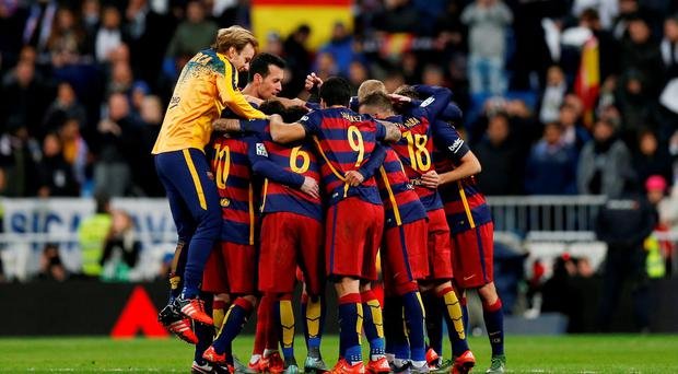 Barcelona players celebrate winning after the match
