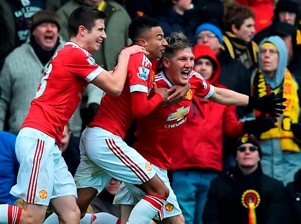 Bastian Schweinsteiger celebrates with Paddy McNair and Jesse Lingard after the late winner, a shot deflected into the Watford net