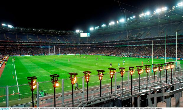 14 torches are lit on Hill 16 to mark the 95th anniversary of the events of Bloody Sunday before the EirGrid International Rules test between Ireland and Australia. EirGrid International Rules Test 2015, Ireland v Australia. Croke Park, Dublin. Picture credit: Brendan Moran / SPORTSFILE