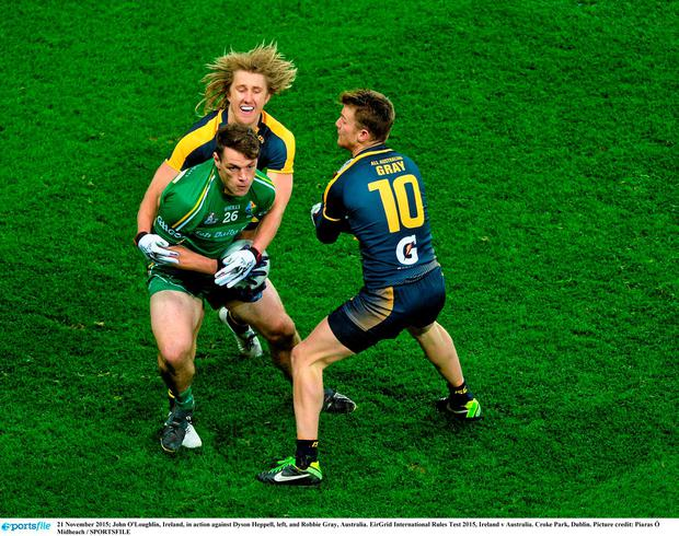 John O'Loughlin, Ireland, in action against Dyson Heppell, left, and Robbie Gray, Australia. EirGrid International Rules Test 2015, Ireland v Australia. Croke Park, Dublin. Picture credit: Piaras Ó Mídheach / SPORTSFILE
