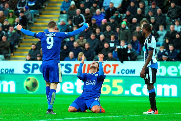 Leonardo Ulloa celebrates his team's second goal with Jamie Vardy
