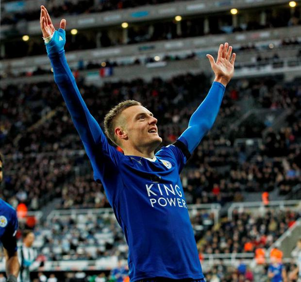 Jamie Vardy celebrates scoring the first goal for Leicester City to equal the record for scoring in consecutive Premier League games