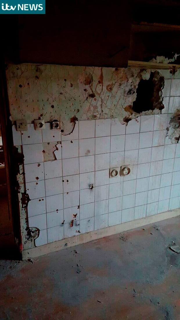 A damaged wall inside the flat in Saint-Denis raided by police following the attacks in Paris. ITV News/PA Wire