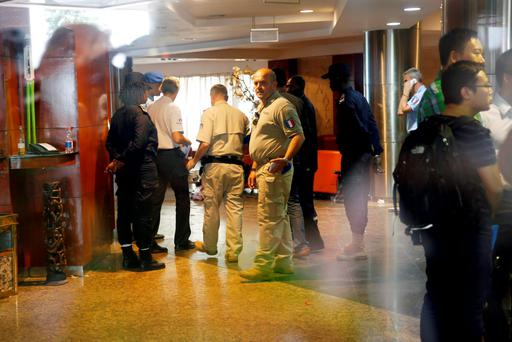French investigators are seen inside the Radisson Blu hotel in Bamako, Mali. (AP Photo/Jerome Delay)