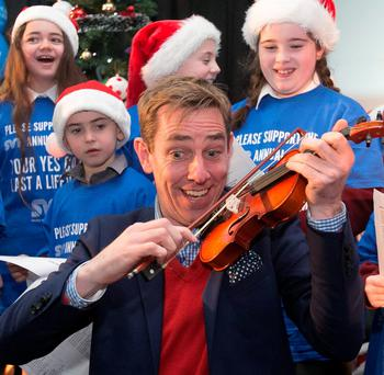 Virtue signalling: Ryan Tubridy with pupils from St Margarets National School during the launch of St Vincent De Paul's annual appeal at their HQ on Sean McDermott Street, Dublin