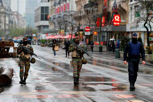 LOCKDOWN: Heavily armed Belgian soldiers and police officers are very visual on the streets of Brussels yesterday