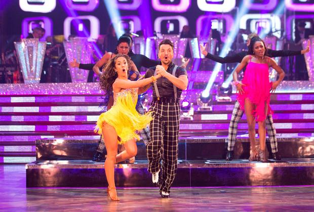 Janette Manrara and Peter Andre appearing on the Strictly Come Dancing live show