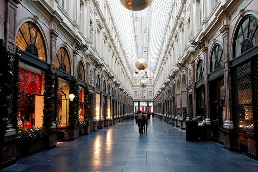 Belgian soldiers patrol a shopping arcade where tourists frequented in central Brussels, November 22, 2015, after security was tightened in Belgium following the fatal attacks in Paris