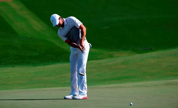 Rory McIlroy lines up his putt during the last day of the DP World Tour Golf Championship in Dubai