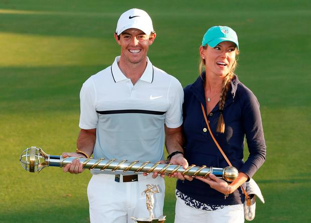 Rory McIlroy celebrates with his girlfriend Erica Stoll and trophies after winning The Race to Dubai and DP World Tour Championship
