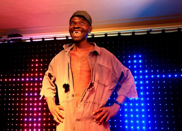 Mison Sere smiles after winning the 2015 edition of the Mr Ugly competition, in Harare, Saturday, Nov. 21.2015. Sere who controversially dethroned former Mr Ugly William Masvinu to scoop the top prize of $500 in a contest marked by allegations of cheating