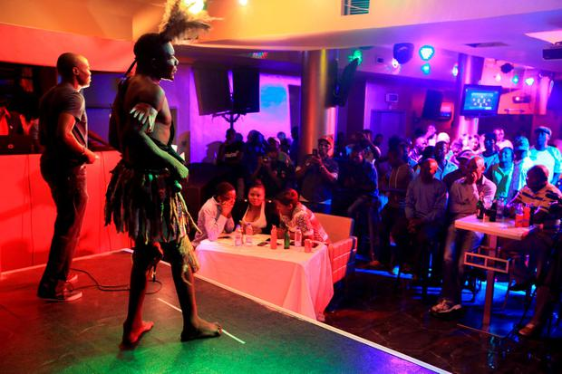 Former Mr Ugly William Masvinu, second left, stands on stage during the Mr Ugly competition, in Harare, Saturday, Nov. 21, 2015