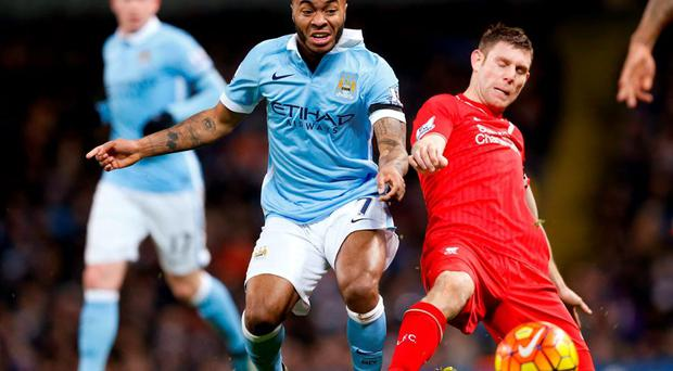 Manchester City's Raheem Sterling in action with Liverpool's James Milner