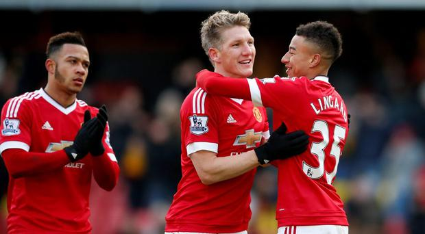 Manchester United's Bastian Schweinsteiger celebrates with Jesse Lingard at the end of the match
