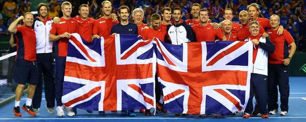 Great Britain's Davis Cup team have delayed travelling to Belgium until Monday amid continuing security fears but are still planning to play in the final.