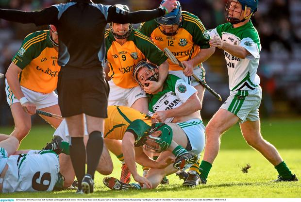 Players from both Sarsfields and Craughwell clash before referee Shane Hynes starts the game. Picture credit: David Maher / SPORTSFILE