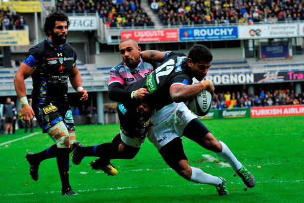 Clermont centre Wesley Fofana scores a try against the Ospreys at the Michelin stadium in Clermont-Ferrand