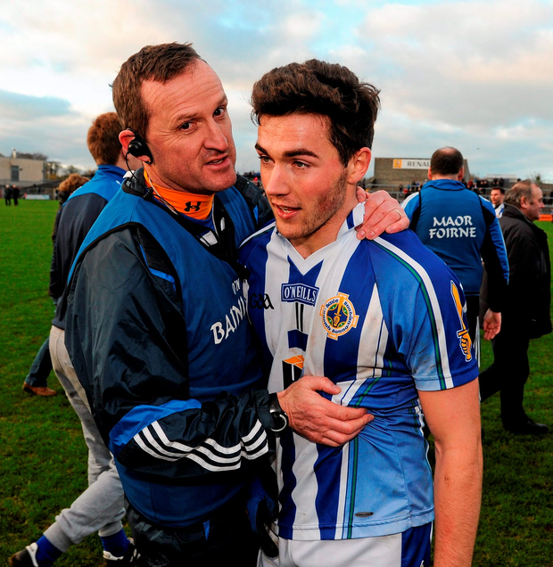 22 November 2015; Ballyboden St Enda's manager Andy McEntee congratulates one of his players, Com Basquel, on their victory after the final whistle. AIB Leinster GAA Senior Club Football Championship Semi-Final, St Loman's v Ballyboden St Enda's. Cusack Park, Mullingar, Co. Westmeath. Picture credit: Seb Daly / SPORTSFILE