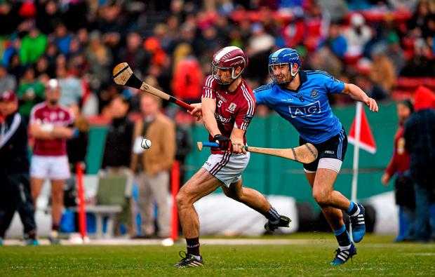 Johnny Coen, Galway, in action against Chris Crummey, Dublin. AIG Fenway Hurling Classic, Dublin v Galway. Fenway Park, Boston, MA, USA. Picture credit: Ray McManus / SPORTSFILE