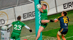 Ireland's Paddy McBrearty collides with the goalpost during the EirGrid International Rules Test on Saturday night at Croke Park. McBrearty went to hospital with bruising to his ribs and kidneys