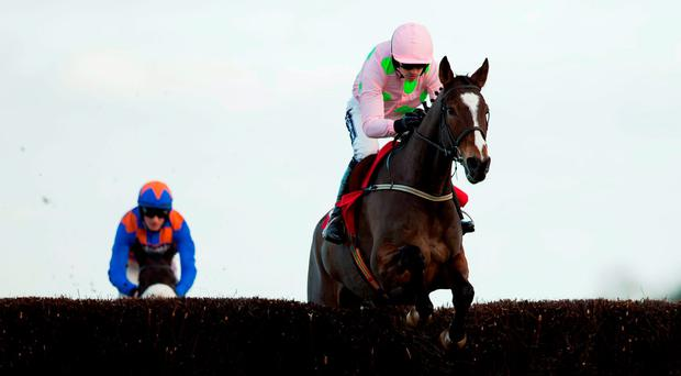 Vautour and Ruby Walsh jump the final fence ahead of runner-up P'tit Zig before going on to victory at Ascot on Saturday getty