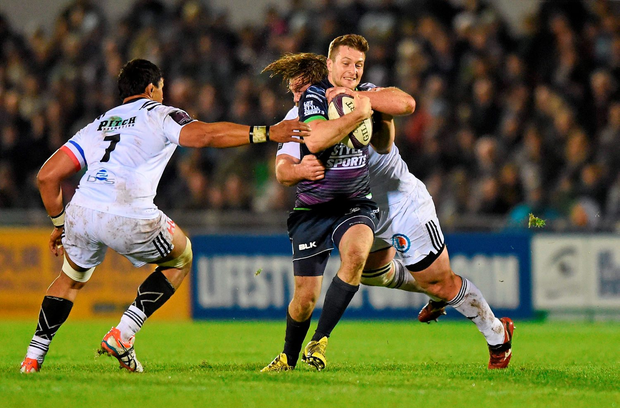 Connacht's Jack Carty shows his determination as he's tackled by Kevin Buys on Saturday night