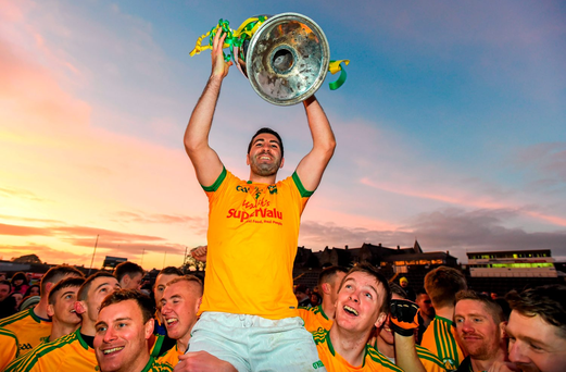 South Kerry captain Bryan Sheehan and team-mates celebrate with the Bishop Moynihan Cup