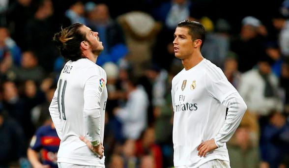 Madrid's Cristiano Ronaldo and Gareth Bale look dejected after Luis Suarez scored the fourth goal for Barcelona